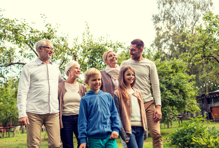 가족, 행복, 세대, 가정 및 사람들 개념 - 행복한 가족 야외 집 앞에 서 스톡 콘텐츠 - 54865592