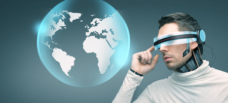 advances: people, technology, future and progress - man with futuristic 3d glasses and microchip implant or sensors over blue background and earth globe hologram