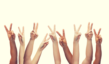 body parts: gesture and body parts concept - human hands showing v-sign Stock Photo