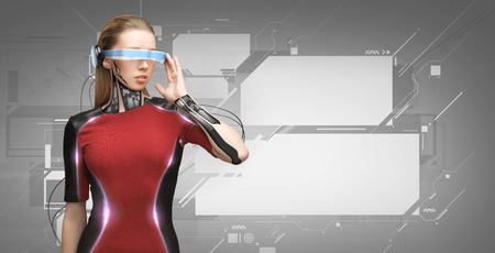 people, technology, future and progress - young woman with futuristic glasses and microchip implant or sensors over gray background with virtual screens