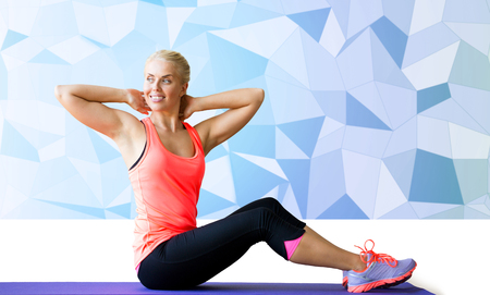 situp: fitness, sport, exercising and people concept - smiling woman doing sit-up on mat over blue low poly background