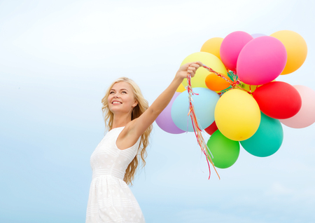 attractive woman: summer holidays, celebration and lifestyle concept - beautiful woman with colorful balloons outside