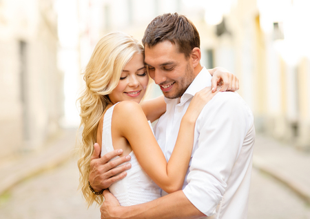thankful: summer holidays, love, travel, tourism, relationship and dating concept - romantic happy couple hugging in the street