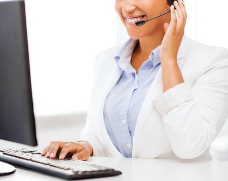 call centre girl: business, office and communication concept - african female helpline operator with headphones