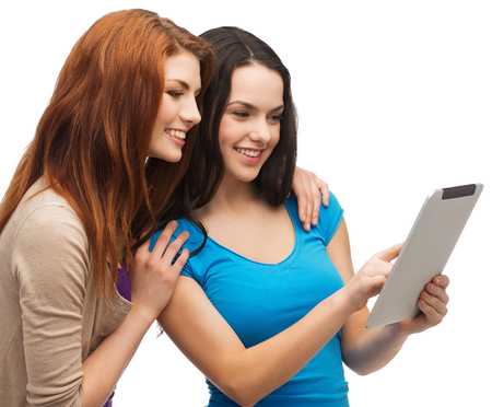 finding a mate: technology, friendship and people concept - two smiling teenagers pointing finger at tablet pc screen