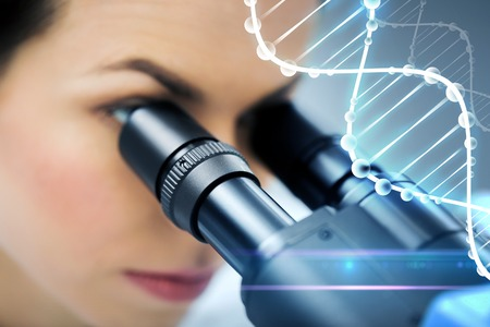 an eyepiece: science, chemistry, technology, biology and people concept - close up of young female scientist looking to microscope eyepiece and making research in clinical laboratory with dna molecule structure Stock Photo