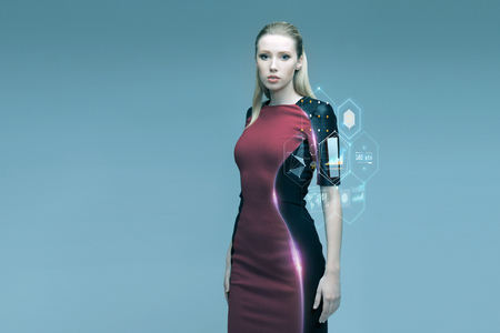 the future: people, future technology and science concept - beautiful futuristic woman with virtual projection over gray background