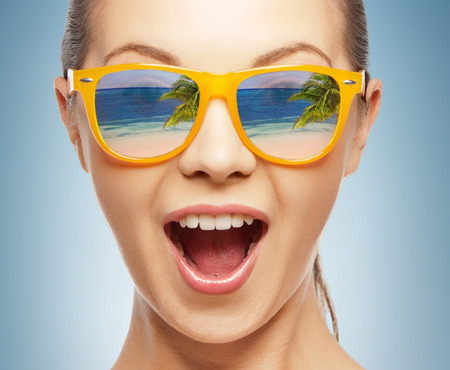 expression: amazed girl in shades with beach reflection Stock Photo