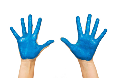 body parts: people, body parts and creativity concept - human hand painted with blue color