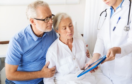 aged person: medicine, age, health care and people concept - senior woman, man and doctor with tablet pc computer at hospital ward