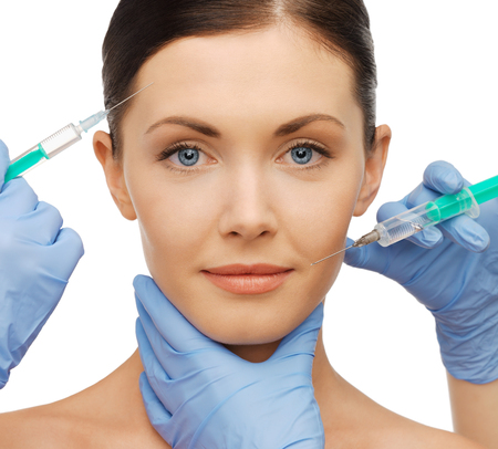 cosmetic surgery: health and beauty concept - woman getting dermall fillers injection