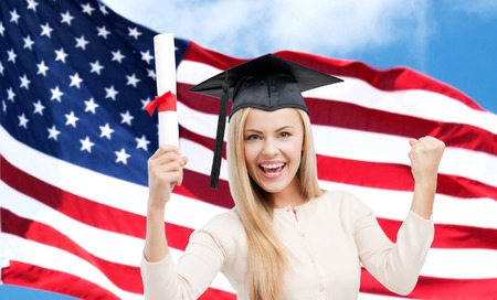 trencher: education, high school, knowledge, graduation and people concept - happy student girl or woman in trencher cap with diploma certificate over american flag background