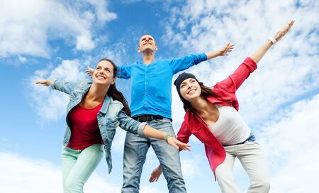 urban culture: sport, dancing and urban culture concept - group of teenagers spreading hands