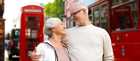 united: family, age, tourism, travel and people concept - happy senior couple over london city street in england Stock Photo
