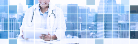 healthcare, medical and technology concept - happy african american female doctor with tablet pc computer over city and blue grid background. Stock Photo