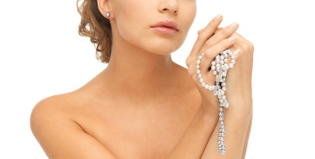 bride bangle: beautiful woman wearing pearl earrings and necklace Stock Photo