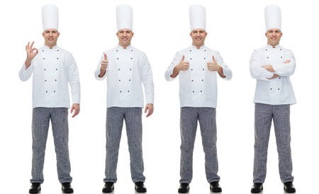 cooking, profession, gesture and people concept - happy male chef cook showing ok and thumbs up hand sign
