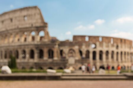 history architecture: architecture, history and tourism concept - Colosseum in Rome blurred background Stock Photo