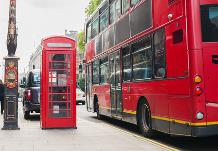 citylife: city life and public places concept - red double decker bus and telephone booth on london street Stock Photo