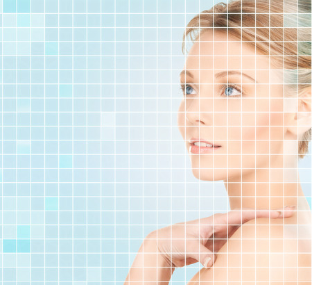 beauty and health: beauty, people and health concept - beautiful young woman touching her bare shoulder over blue background with squared grid