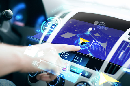 navigator: transport, destination, modern technology and people concept - male hand searching for route using navigation system on car dashboard screen