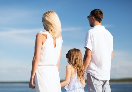 children celebration: summer holidays, celebration, children and people concept - happy family at the seaside