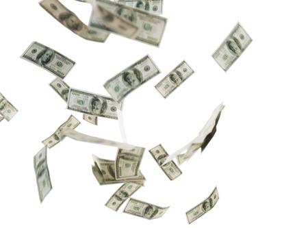 money flying: negocios, las finanzas, los residuos y el concepto - cerca de nosotros dinero del dólar volando sobre fondo blanco