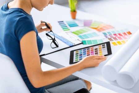 computer graphic: woman working with color samples for selection Stock Photo