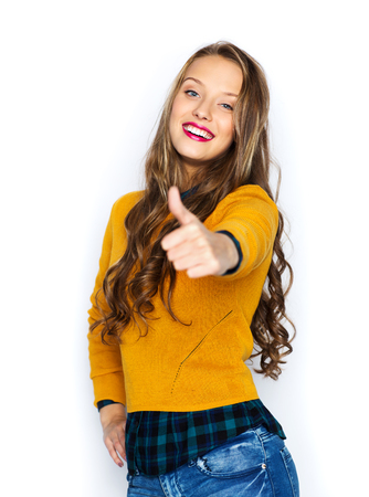 posing  agree: happy young woman or teen girl in casual clothes showing thumbs up
