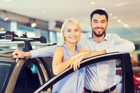 latin family: happy couple buying car in auto show or salon