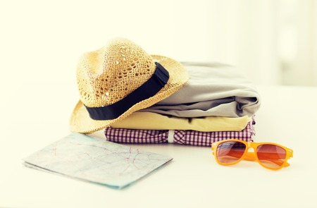 touristic: close up of folded clothes and touristic map on table at home