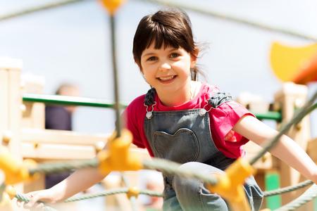 pretty preteen: happy little girl on children playground climbing frame