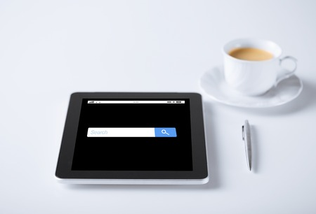 internet browser: tablet pc computer with internet browser search bar and cup of coffee