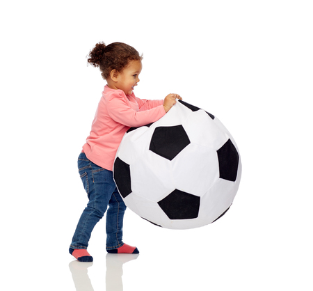 child ball: childhood, game, football and people concept - happy african american little baby girl playing with ball