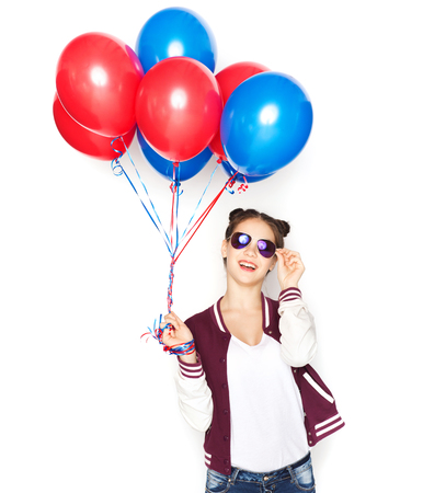 helium: people, teens, holidays, party and summer concept - happy smiling pretty teenage girl in sunglasses with helium balloons