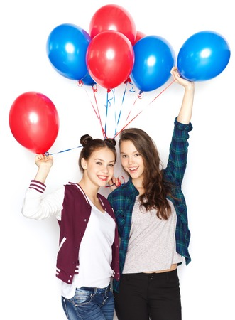 helium balloon: people, friends, teens, holidays and party concept - happy smiling pretty teenage girls with helium balloons