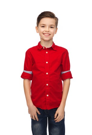 young boy smiling: childhood, fashion and people concept - happy smiling boy in red shirt