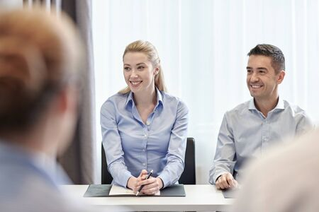 worker man: business, people and teamwork concept - group of smiling businesspeople meeting in office Stock Photo