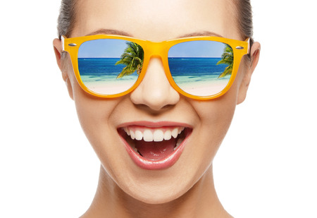 amazed girl in shades with beach reflection Stockfoto