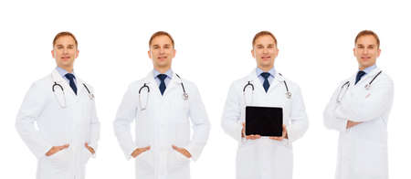 health care and medicine: medicine, profession, technology and health care concept - happy doctors with tablet pc computer and stethoscope Stock Photo