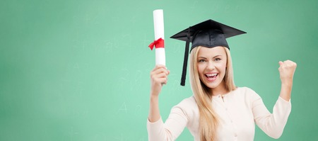 trencher: education, high school, knowledge, graduation and people concept - happy student girl or woman in trencher cap with diploma certificate over green chalk board background