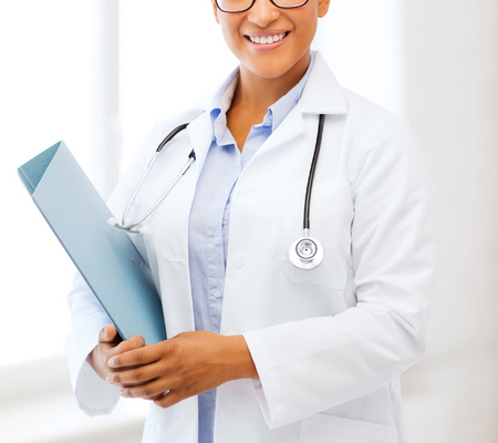 pathologist: healthcare and medical concept - smiling african female doctor in hospital