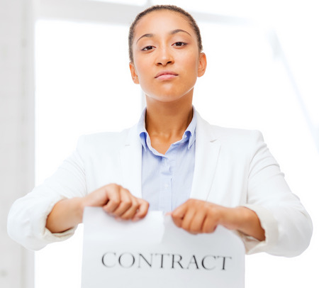 breaking the rules: business and office, legal concept - african businesswoman tearing contract Stock Photo