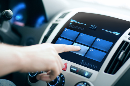 touch screen: transport, modern technology and people concept - male hand pushing button on car control panel screen Stock Photo