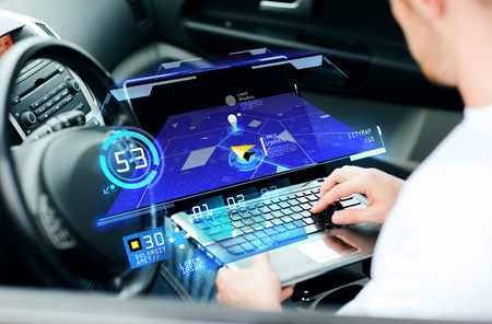 car navigation: transport, modern technology and people concept - man using navigation system on laptop computer in car Stock Photo