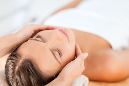aging: health, beauty, resort and relaxation concept - beautiful woman in spa salon getting face treatment Stock Photo
