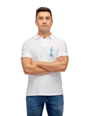 mani incrociate: medicine, health care, gesture and people concept - middle aged latin man in t-shirt with blue prostate cancer awareness ribbon pointing finger on himself