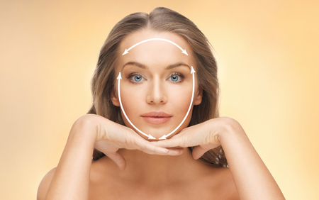 facelift: people, beauty and hair care concept - beautiful woman face with long blond hair