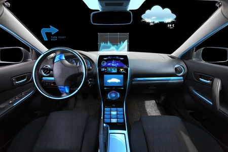 dash: transport, destination and modern technology concept - car salon with navigation system on dashboard and meteo sensor on windshield