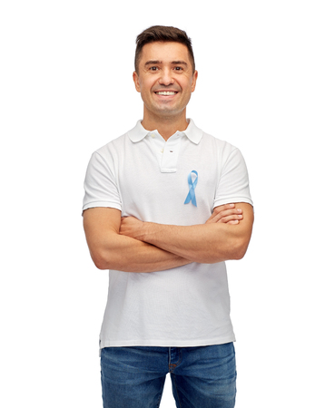 aged: medicine, health care, gesture and people concept - middle aged latin man in t-shirt with blue prostate cancer awareness ribbon pointing finger on himself
